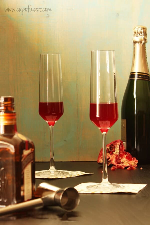 Orange Pomegranate Sparkling Cocktail with Ingredients