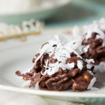 Chocolate Coconut Clusters - These NO-BAKE bites of goodness are inspired by a 1956 recipe and perfect for the chocolate lover in your life!