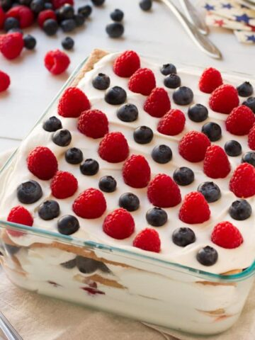 No-Bake Berry Icebox Cake - This 1930's inspired recipe is easy, packed with perfectly ripe berries, and a crowd pleaser. It's perfect for your next BBQ.