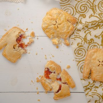 Ugly Sweater Hand Pies - These retro looking desserts are so delicious and easy to make! You should make them for your next holiday party! - #cupofzest #partyfood #retrorecipe #vintagerecipe #vintageinspired #uglysweaterparty #easydessert #handpies #christmaspartyfood #dessert #pie #retrodessert #easyrecipe
