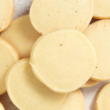 a horizontal overhead of multiple shortbread cookies stacked on top of each other.