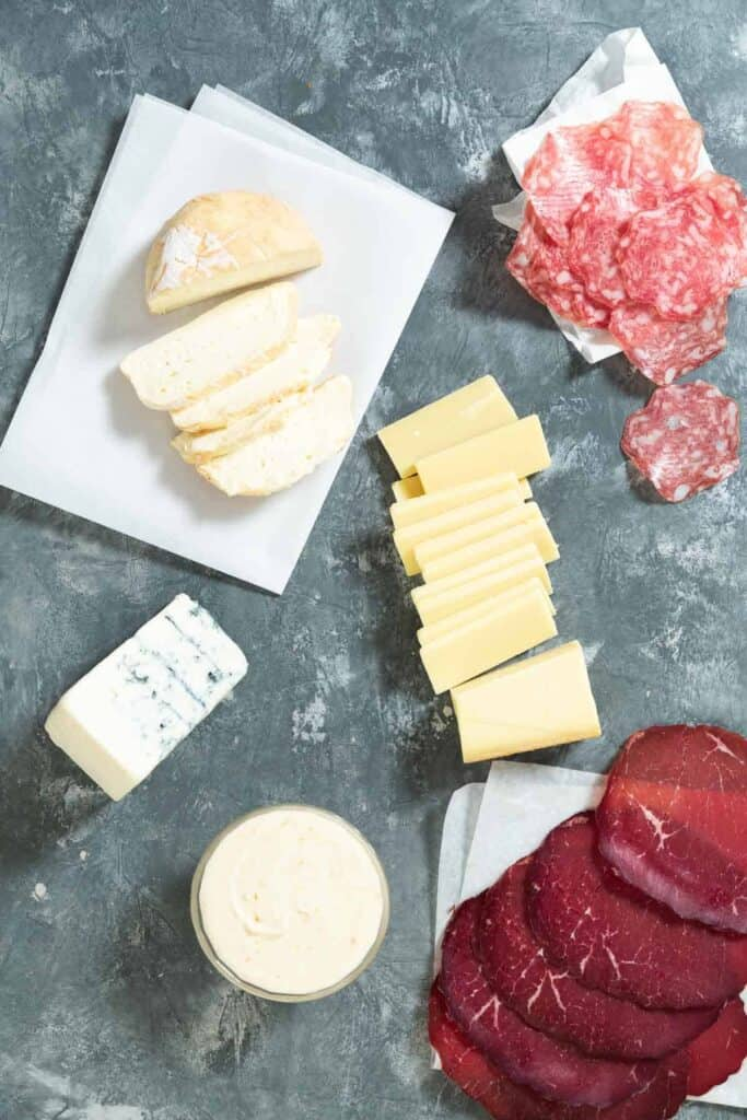 four different cheeses and two types of charcuterie