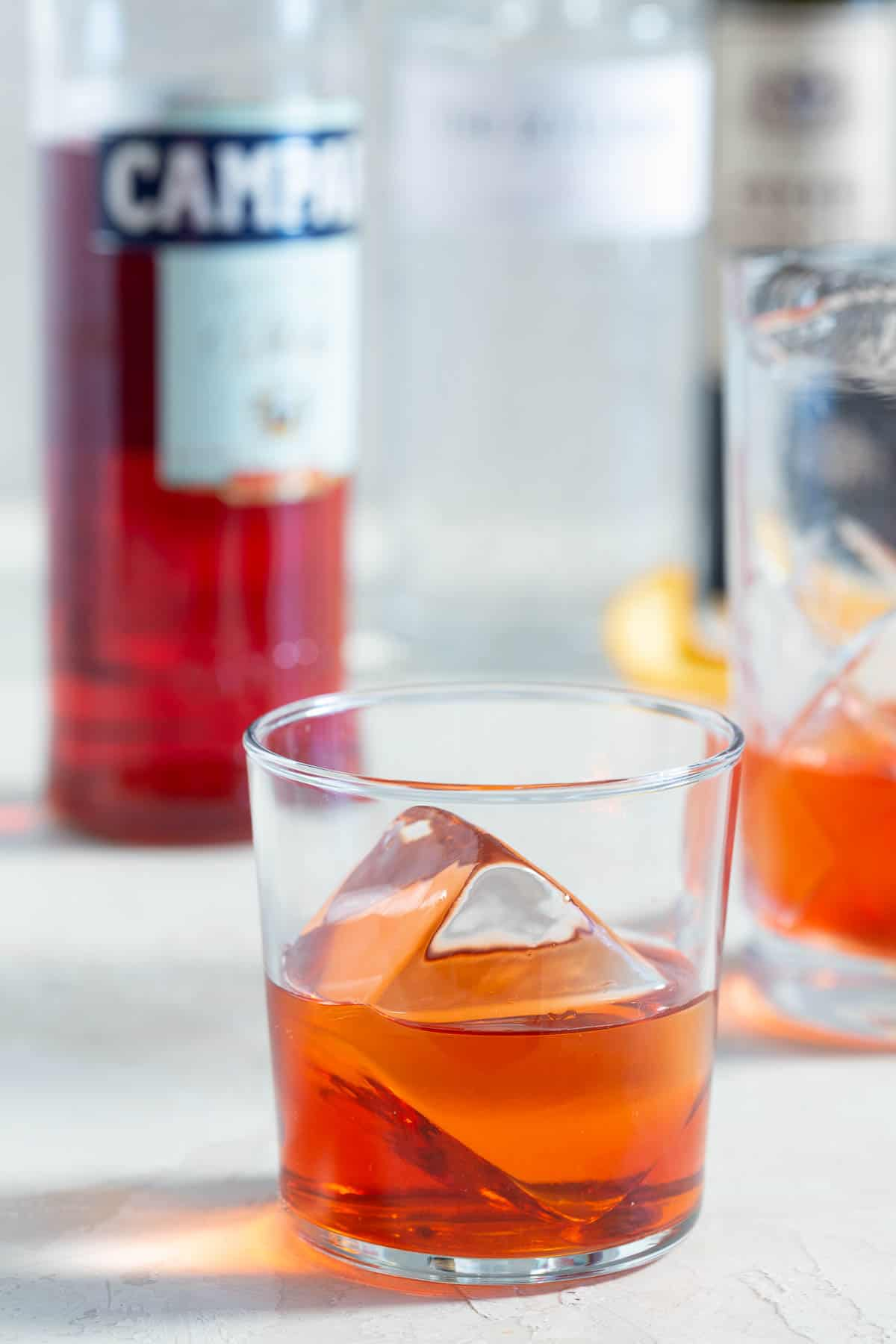 Negroni in a clear rocks glass with a large ice cube