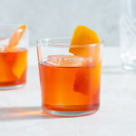 Close-up of a Negroni in a glass with an orange peel