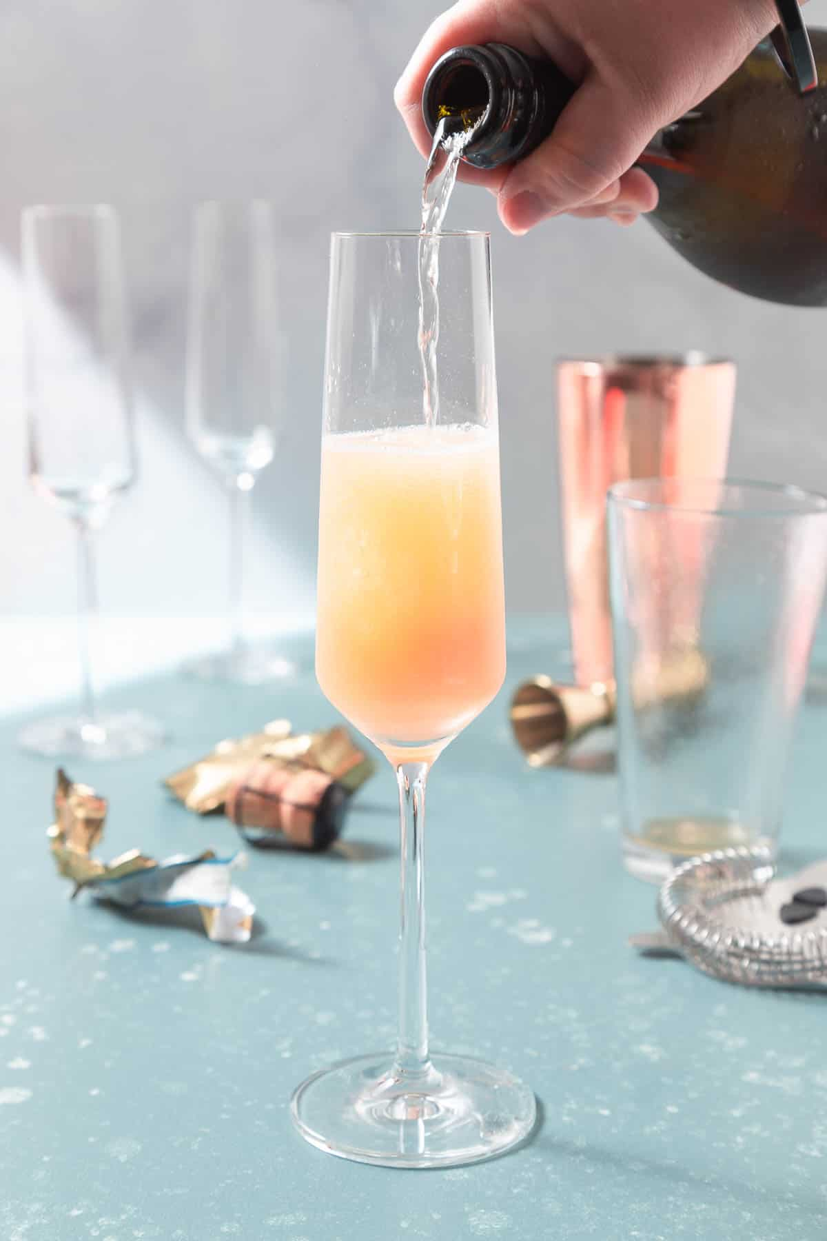 Pouring sparking wine into a glass champagne flute