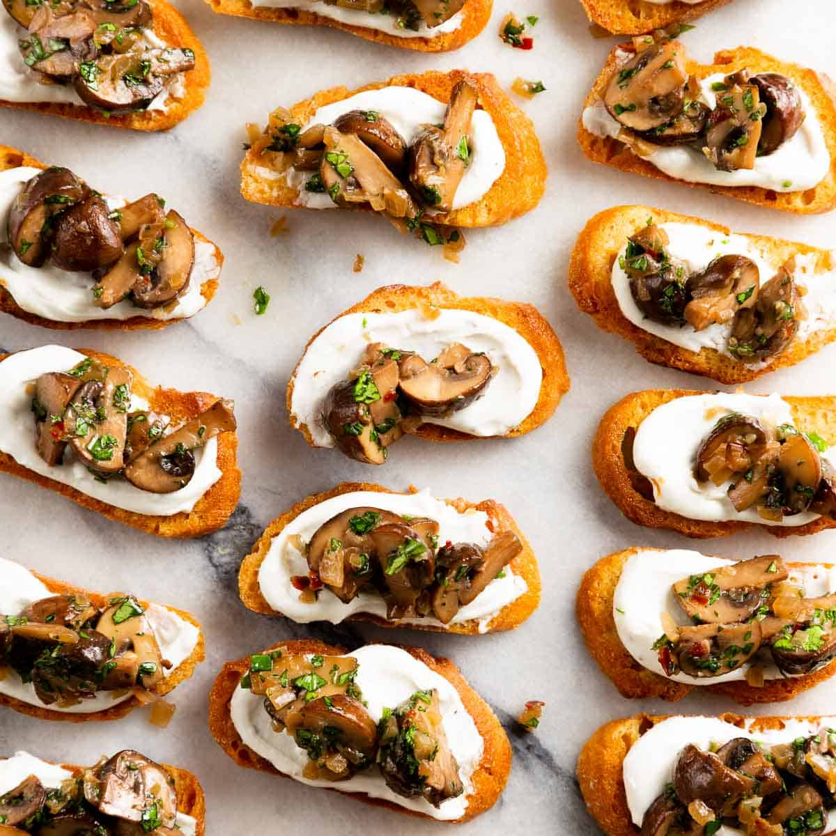 Close up of mushroom crostini on a marble slab