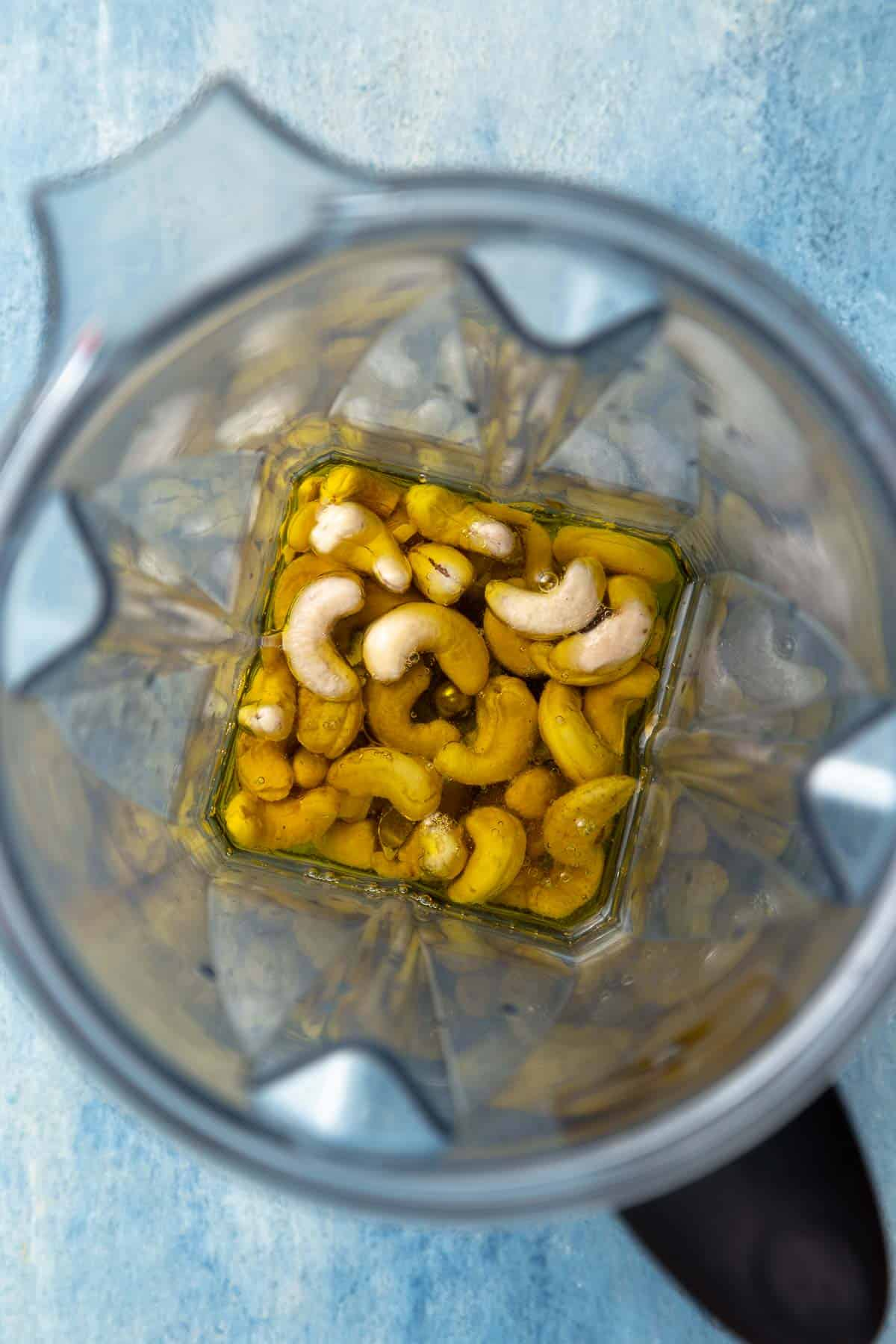 Cashews and oil in a blender