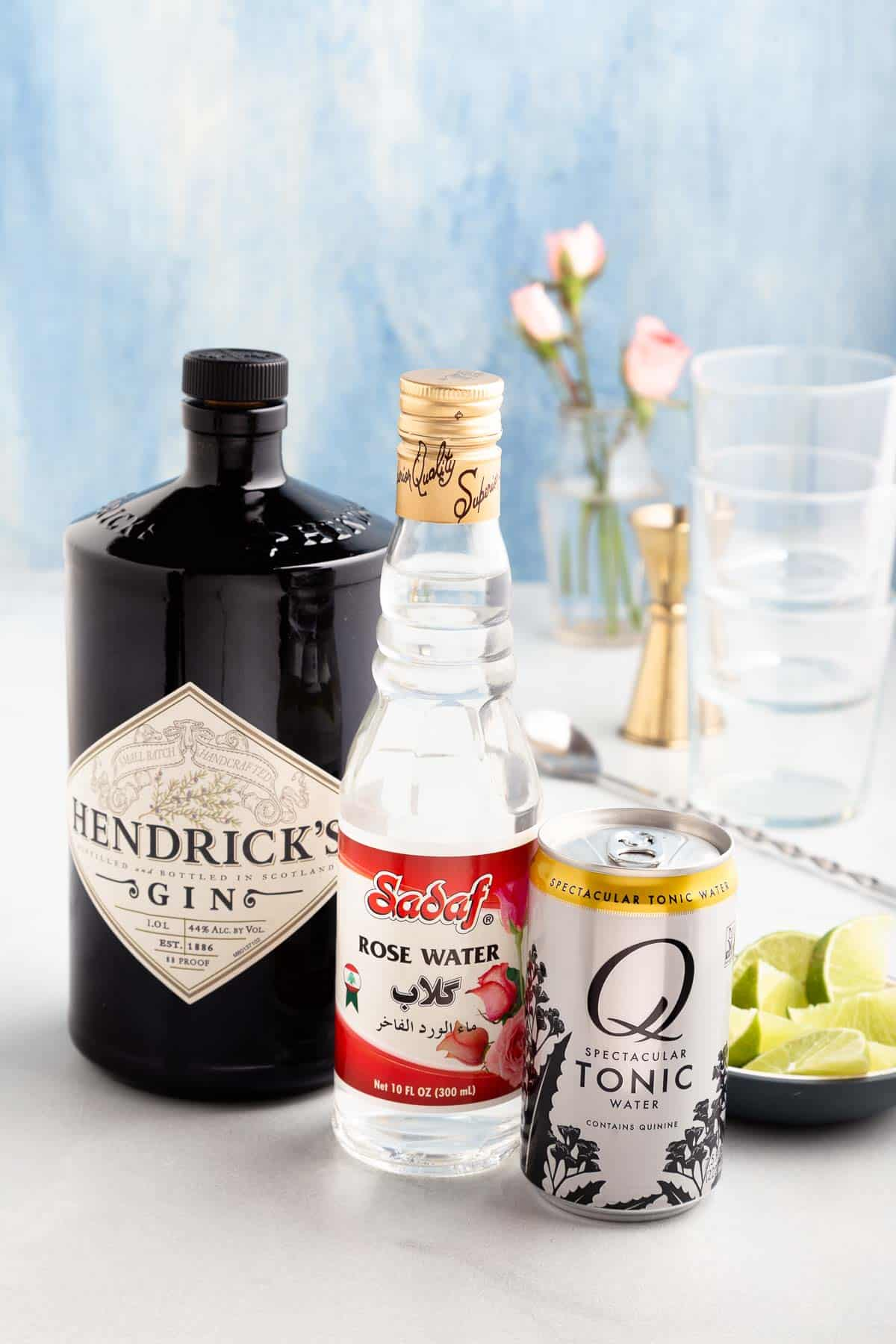 bottles of gin, rose water, and tonic