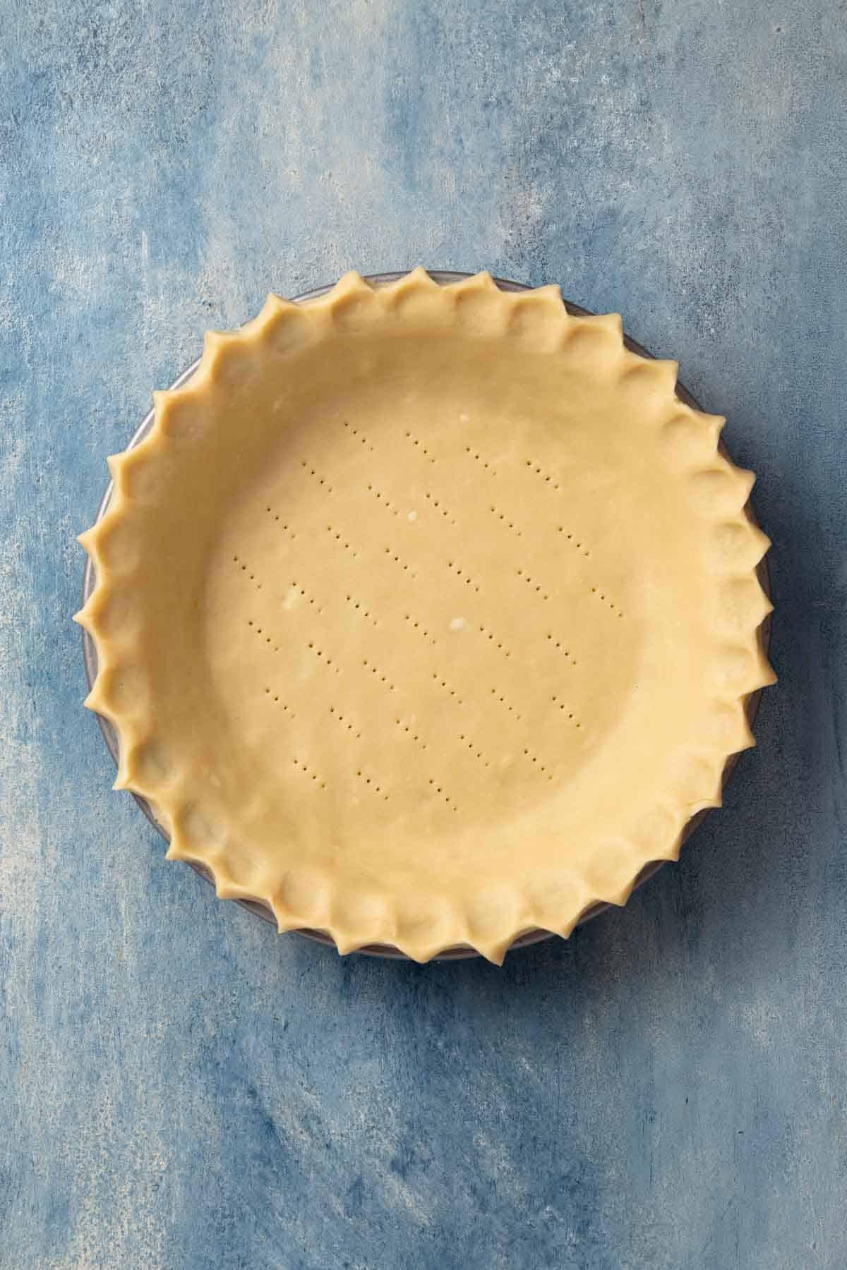 docked pie dough in a pie plate