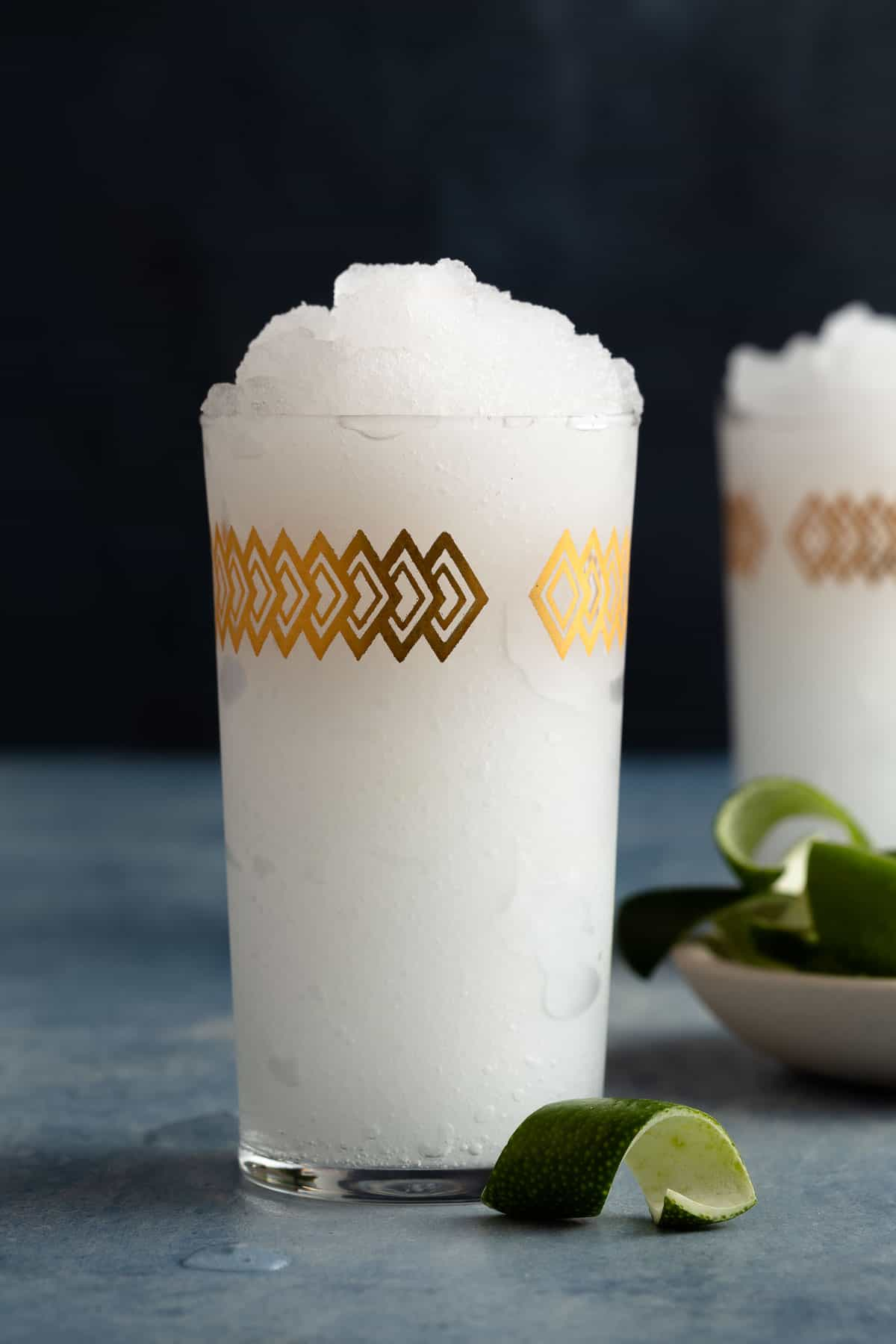 tall glass filled with a white frozen gin and tonic