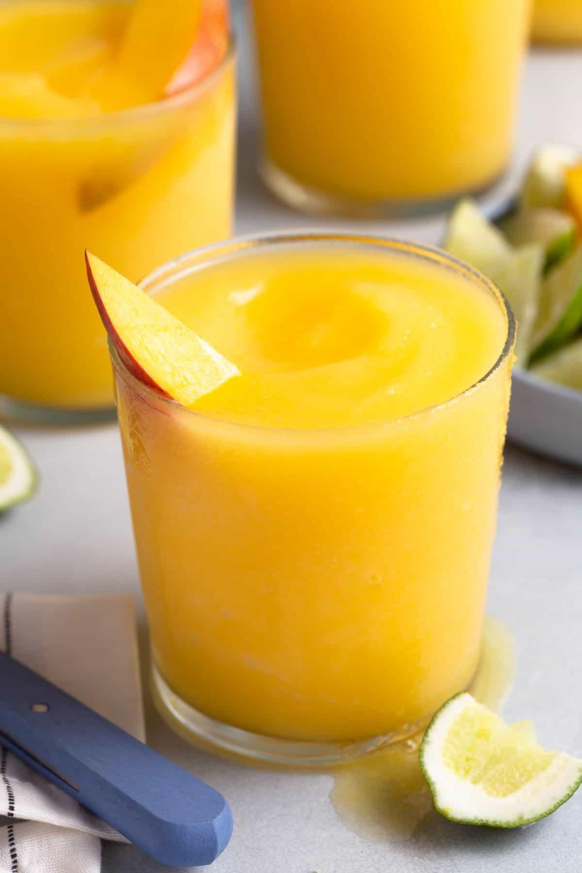 yellow frozen mango margarita in a glass