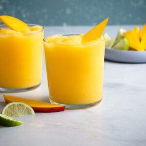 2 blended mango margaritas in glasses