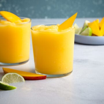 2 blended mango margaritas in glasses