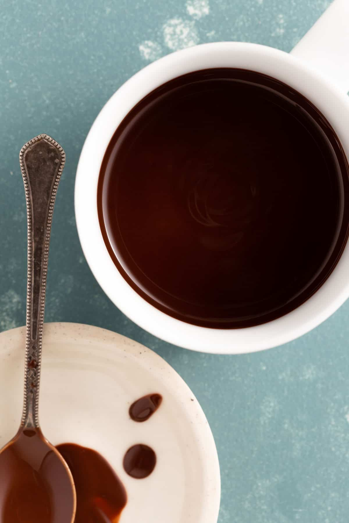 close up on a white bowl with melted chocolate